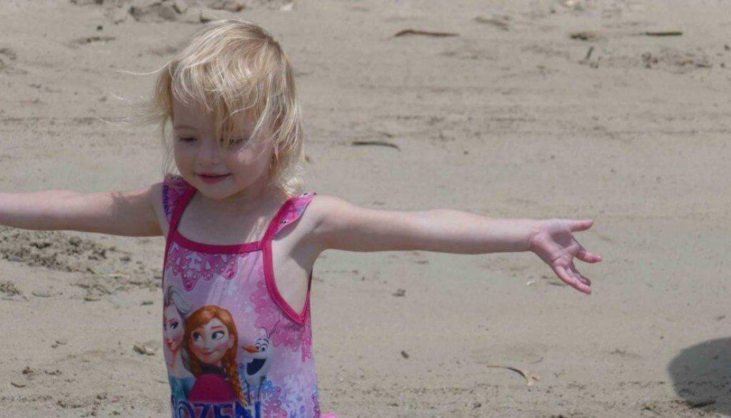 girl happy at beach