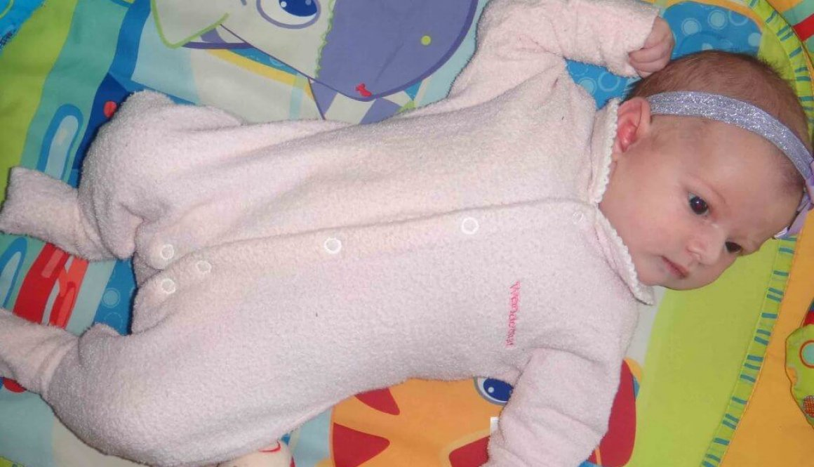 baby lying on play mat